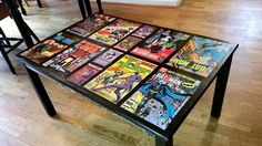 A buddy of mine put together a comic themed coffee table for his superhero themed living room.