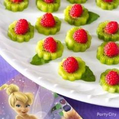 Shape kiwi fruit with flower cutter then add strawberry or raspberry. Leaf of basil or mint ... Girls Party Food Idea by tracie