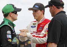 Trevor Bayne, center, talks with Ricky Stenhouse Jr, left, during practice for Sunday's NASCAR Daytona 500 auto race in Daytona Beach, Fla., Wednesday, Feb. 22, 2012. (AP Photo/Terry Renna)