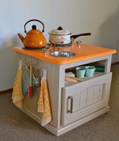 Another great idea for a kid's play kitchen made out of an old TV stand
