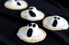 No need to be scared: You can use packaged cookie mix to make the base for these little ghosts. Semi-melted marshmallows and frosting are all you need to complete the spooky look. #Halloween