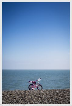 Bicycle on a beach by Nigel Lomas on 500px