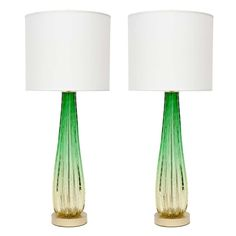 Pair of Mid-Century Italian stylized elongated teardrop shaped fluted glass lamps with controlled air bubble technique by Barovier. Lamps feature double pull chain sockets and satin brass disc bases.  1950's  32 H x 6 Diam.