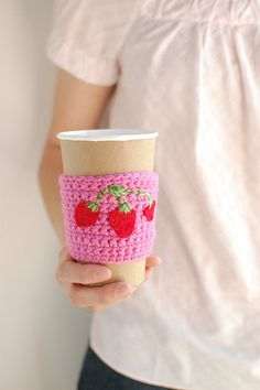 Coffee cup cozy  Pink with strawberries by The Cozy Project. $16.00, via Etsy.