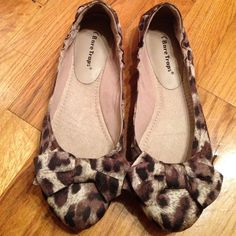 Cheetah print flats Cheetah print flats with bow design in front. In back has adjustable stretch. This shoe is very comfortable due to sole. Great condition. I wore twice. Bottom is dark due to rubber like sole. All man made material. Brand is Bare Traps. Shoes Flats & Loafers