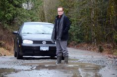 Bradley Gionet stands in one of the many potholes that make a trip down the forest service road to his family home treacherous. Forest Service, Home And Family, Times, Car, Automobile, Cars