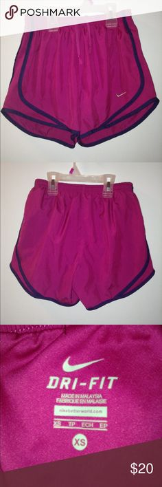 Women's Nike Dri Fit Pink Shorts NWOT I'm selling a barely worn, Nike Dri Fit pink shorts in excellent condition. It's great to work out. Comes with built In underwear and a small secret pocket inside. Very nice material. Made with 100% polyester. Very cute shorts! Size- XS Nike Shorts