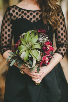Bouquet made of: Cymbidium orchids, Xerographica, air plants, succulents, and greenery