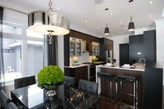 Suzie: Atmosphere Interior Design - Modern kitchen & dining room combo design with glass dining ....