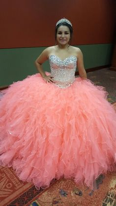 Coral quincenera dress by Debi's Bridal