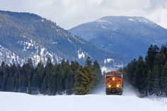 https://flic.kr/p/RmzLWi   Hot and Cold   Spewing heat waves and kicking up icy powder, BNSF Railway ES44C4 No. 8240 charges west through snow-covered Trout Creek, Montana, on Montana Rail Link's 4th subdivision.