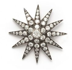 Star-shaped brooch, set with antique cut diamonds.