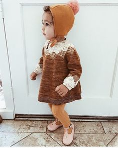 Outfit goals  Love this #mishaandpuff tunic paired with tights and a bonnet! ps. we still have #briarhandmade pom pom bonnets in all colors available on the site and theyll be arriving to us soon for all those whove pre-ordered and are wondering where is my bonnet  #howwestyledarlingclementine by @cosettepenny