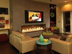 Low profile wide fireplace with TV above...(I love fireplaces that go up high but this is super neat!)