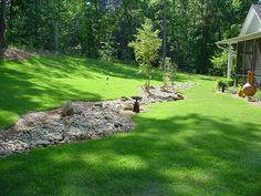 Dry creek river bed dry creek bed drainage for Landscaping rocks augusta ga