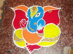 Check out latest ganesh rangoli designs and patterns which you can use to decorate your home this ganesh chaturthi. Rangoli Designs Photos, Indian Rangoli Designs, Rangoli Designs Latest, Rangoli Designs With Dots, Rangoli With Dots, Beautiful Rangoli Designs, Diwali Designs, Latest Rangoli, Rangoli Colours