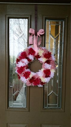 A personal favorite from my Etsy shop https://www.etsy.com/listing/264835891/pom-pom-wreath-valentines-day-wreath