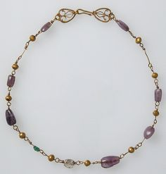 Gold Necklace with Amethysts, Glass, and Gold Beads Date: 6th–7th century Culture: Byzantine Medium: Gold, amethyst, (colored glass or rock crystal and emerald) beads Dimensions: Overall: 17 9/16 x 9/16 x 1/4 in. (44.6 x 1.4 x 0.6 cm) Classification: Metalwork-Gold