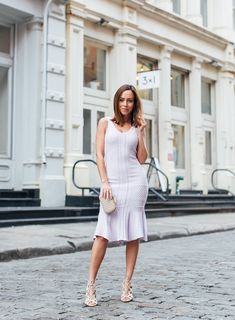Sydne Style shows what to wear in new york city in a summer knit dress
