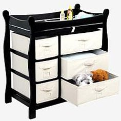 This Badger Basket changing table keeps everything tidy and concealed for a clean look in the nurseryThe changing area has safety rails on all four sides for complete safetyThis table has six baskets to help you stay organized