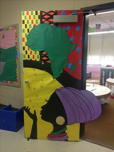 Our Africa-themed door for International Night (made from bulletin board paper, construction paper, and metallic paper stars)
