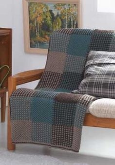 Simple techniques and striping create the illusion of plaid in this quick and easy afghan.