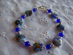 Hey, I found this really awesome Etsy listing at https://www.etsy.com/listing/80430481/beautiful-blue-millifiori-glass-beaded