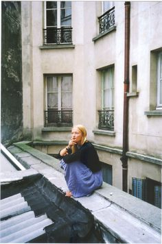 Sitting on a rooftop in Paris? Sounds like the life for me...minus the cig.