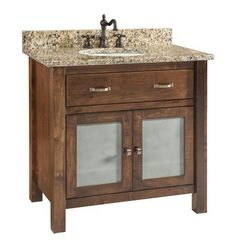 Amish Lehigh Solid Wood Bathroom Vanity For soaps, shampoos, candles and towels, the Lehigh looks marvelous! Custom made vanity with choice of: wood, stain, hardware, door type, counter material and bowl style. Made in America. #bathroomvanity #bathroom