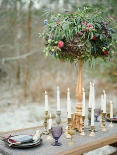 Tall floral centerpiece and candles | Warmphoto | see more on: http://burnettsboards.com/2015/02/winter-coming-game-thrones-wedding/