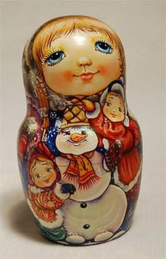 Matryoshka (Russian nesting doll) painted with two little girls and a snowman.