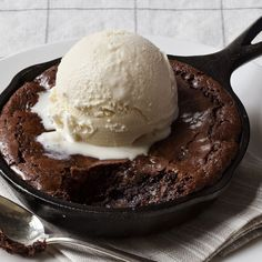 Tasty Skillet Brownies topped with vanilla ice cream.