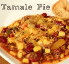Tamale Pie is a savory and hearty Mexican meal packed with plenty of vegetables & beans. Cheddar cheese on top and Fritos on the side make it awesome!