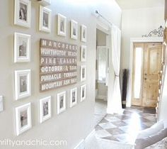 Entryway with pictures & handpainted barn boards with meaningful places