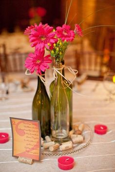 wine bottle centerpieces, paint with mercury glass, use other flowers