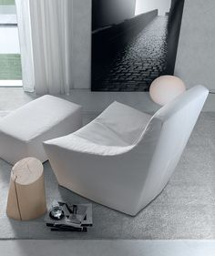 The sloping lines of design's Julie Lounge Chair work in beautiful contrast to the matching, square ottoman. Find it at Home. Upholstered Furniture, Bedroom Furniture, Home Furniture, Square Ottoman, Luxury Kitchens, Luxury Furniture, Jessie, Floor Chair, Living Area