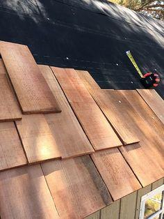 Cedar shake roof on a garden shed by littlegreennotebook