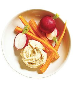 Two to four tablespoons of hummus with crudités.   They're under 200 calories, healthy, satisfying, and pro-approved―what's not to love?