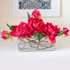 this realistic artificial design features the finest and high quality faux fuchsia peonies in a contemporary arrangement. It's perfect for home decor, office desk or even for wedding. Those peonies in fuchsia are not only lovely but also last forever. Some faux (fake) water is also added to increase realism. $125.00