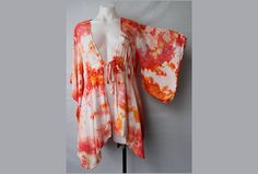 $52- Tie dye Kimono Ice dye  Find this item on https://www.etsy.com/shop/ASPOONFULOFCOLORS?ref=hdr_shop_menu
