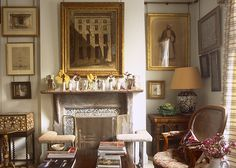 Art gallery walls. Hang frames with antiqued chains/ hardware  Robert Kime's art-filled London apartment library