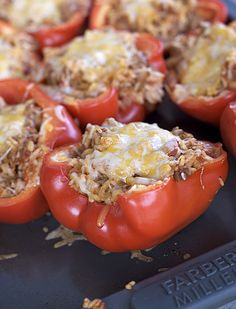 Stuffed Bell Peppers ~ Made this tonight. Essentially a basic chili minus beans with rice inside a red pepper. Kids liked the meat part. Peppers not so much. Next time instead of stuffing, I'm going to cut the pepper into very small pieces and put in the mixture. Served with black beans.