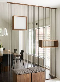 I love this for between the living room & dining room! Brushed chrome pipes of varying diameter, could house wires to light box shelves made to match the internal doors. Love!