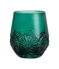 Verre en verre coloré avec motif en relief à la base. Diamètre en haut 7 cm, hauteur 10 cm.