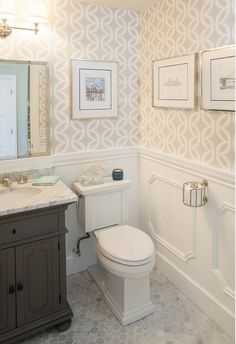 Chic powder room features top half of walls clad in beige geometric wallpaper and lower walls clad in decorative moldings lined with a gray vanity, Restoration Hardware St. Cute for small bathroom Downstairs Bathroom, Bathroom Renos, Bathroom Ideas, Bathroom Marble, Bathroom Designs, Wall Paper Bathroom, Half Bathroom Wallpaper, Bathroom Stencil, Beige Bathroom