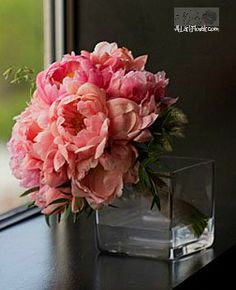 Coral Wedding Flowers Gold Wedding Inspirations Peony Bridal Bouquet finished with unique foliage accents.  Floral Designs by: At Last Florals  Image by: Ashley Danielle Photography