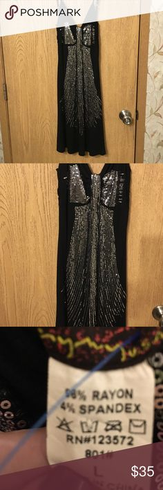 Black silver sequined bow front dress Black and silver bow front dress with spaghetti straps. Never worn Dresses Mini