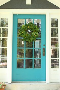 the best front door paint colour is teal on a yellow or gray home