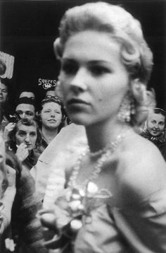This photo says so much about how I feel about fame. She thinks she's the shit but the photographer actually focused on the crowd and not her. (Robert Frank)