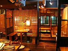 Interior of an izakaya, possibly of the Tsubohachi chain mentioned in the mini-article? Anyway, I think it looks fantastic and I love the idea of the izakaya.